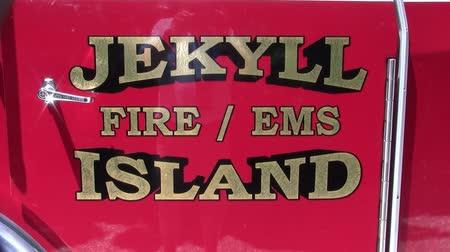 Jekyll Island, Georgia, USA - Circa July 2013: Jekyll Island Fire Department and EMS Logo on the Red Door of a Fire Engine in Glynn County, Georgia. Stock Footage