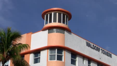 Miami, Florida, United States - Circa July 2013: The orange and white Art Deco facade of the Waldorf Towers on the famous Ocean Drive in Miami Beach, designed by Albert Anis in 1937.