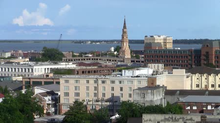 sc : Cityscape of Charleston, South Carolina with the Spire of St. Phillips Episcopal Church, Aerial View with the Sea in the Background Stock Footage