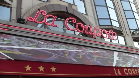 Paris, France - Circa July 2013: Neon Sign at the Entrance of the Famous Restaurant La Coupole on Boulevard Montparnasse