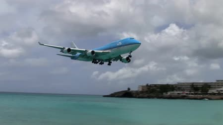 Maho Beach, Sint Maarten - Circa July 2013: KLM 747 Jumbo Jet Landing Approach at dangerous Princess Juliana Airport on Sint Maarten. Airliner flying low over the heads of tourists. Stock Footage