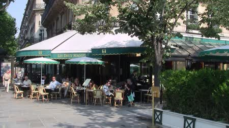 Paris, France - Circa July 2013: Les Deux Magots, a Famous Cafe and Restaurant in Paris, France, in Summer, with Patrons Sitting Outside and a Waiter