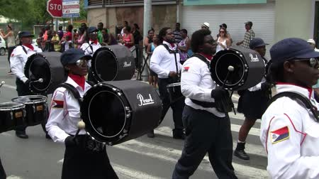 Marigot, Saint Martin - July 14 2013: Creole band with Uniform and Drums at Parade on the 14th July, the French National Holiday in Marigot. Afro-Caribbean Musicians celebrating Bastille Day. Stock Footage