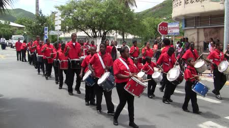 Marigot, Saint Martin - July 14 2013: Creole band with Red Shirts and Drums at Parade on the 14th July, the French National Holiday in Marigot. Afro-Caribbean Musicians celebrating Bastille Day. Stock Footage