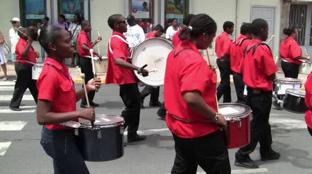 Marigot, Saint Martin - July 14 2013: Creole band withe Red Shirts and Drums at Parade on the 14th July, the French National Holiday in Marigot. Afro-Caribbean Musicians celebrating Bastille Day.