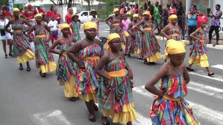 Marigot, Saint Martin - July 14 2013: Creole Girls in Traditional Colorful Garment Dancing at Parade on the 14th July, the French National Holiday in Marigot on the Tropical Island Saint Martin, also called Sint Maarten in the Caribbean