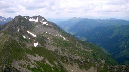 Aerial View of High Alpine Mountain Summit with Patches of Snow in the Alps in Carinthia, Austria