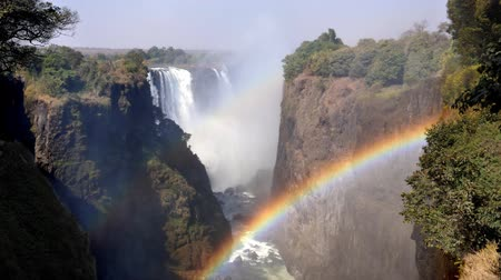 zambia : Victoria Falls and Gorge with Rainbow, Zambezi River, between Zimbabwe and Zambia, Africa
