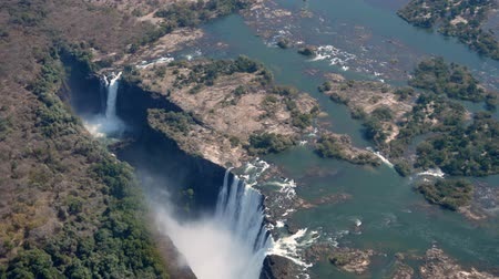 ravina : Spectacular Aerial View of Victoria Falls between Zimbabwe and Zambia, Africa from Helicopter in 4k