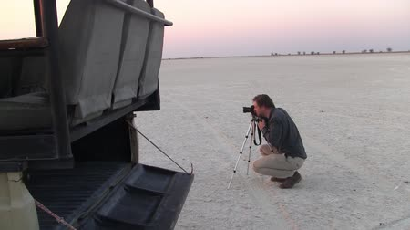 professional photography : Photographer Taking Picture in Makgadikgadi Salt Pans Stock Footage