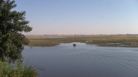 Boat for Animal Watching on Chobe River in Beautiful Landscape of Chobe National Park, Botswana, Africa