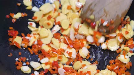 Cooking Chopped Garlic, Red Chili, Ginger, Stirring with Spatula, for Three Cup Chicken or San Bei Ji in a Wok