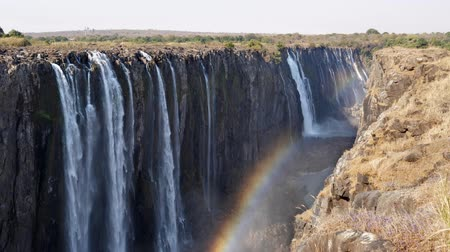 zambia : Majestic Victoria Falls Waterfall with Rainbow on Zambezi River in Zimbabwe, Africa