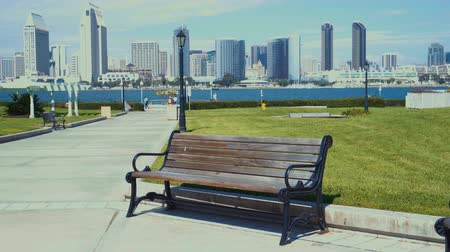 4K San Diego skyline view from Coronado Centennial park with park bench on the foreground.
