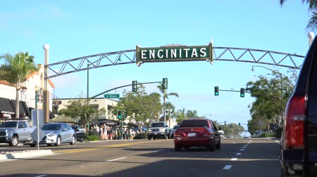 4K City of Encinitas California. Cars driving on highway 101 under a large archway sign identifying the city. Wideo