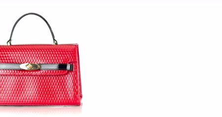 4K stop motion animation of red handbag moving on white background