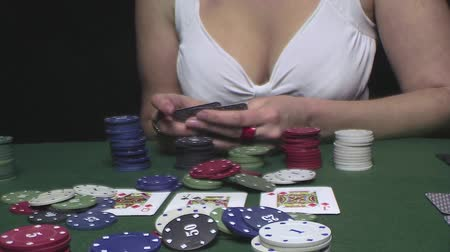 szerencsejáték : Attractive woman playing a game of poker Stock mozgókép