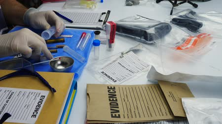 criminology : Police scientist working in Criminalistic Laboratory, bullet shell analysis, conceptual image
