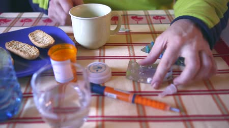 dose : Medication during breakfast, capsules next to a glass of water