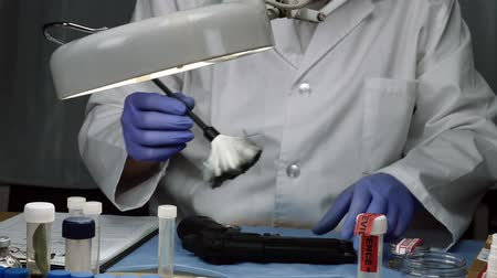 criminology : Scientific police officer examining traces of a gun in ballistic laboratory