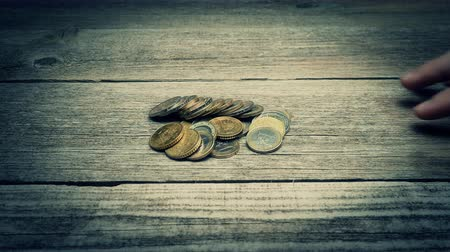 empilhamento : Hand giving money - Euro coins - on the wooden table. Another hand is taking money. Bribing concept.