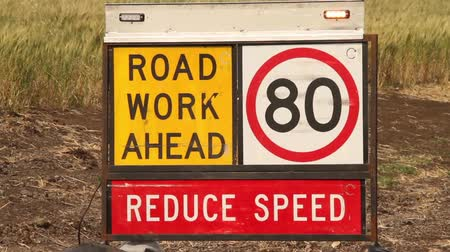 uyarmak : Road work ahead - reduce speed sign Stok Video