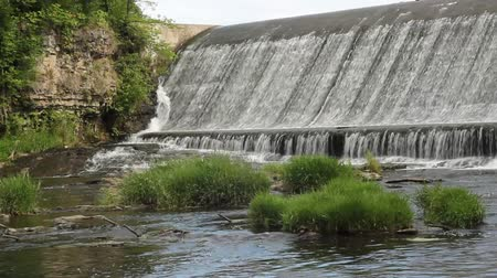 water flowing over a small concrete dam