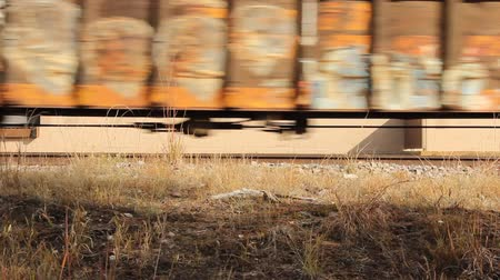 low angle view of railroad boxcars passing by on the tracks Wideo
