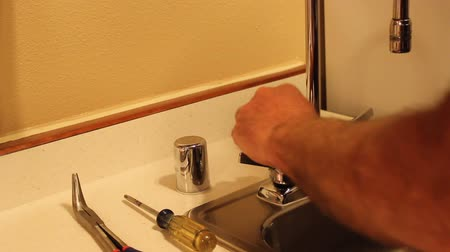 repairing the kitchen sink handle