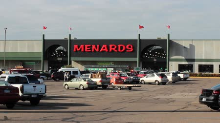 RIVER FALLS,WISCONSIN-OCTOBER 15,2014: Patrons entering and leaving a local Menards lumber store.