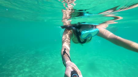 limpid : Pretty girl driving with snorkel on the clear water in Spain ,village Palamos