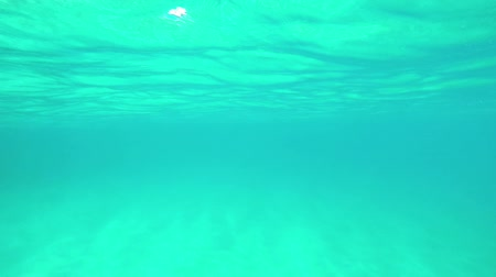 Transparent blue water footage in a Spanish ocean in Costa Brava, Slow motion