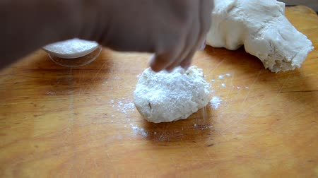 mixing bowl : Making dough by female hands at bakery. kneading. dusting of flour Stock Footage