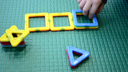 aritmética : Children toddlers girls or boy play logical toy learning shapes, arithmetic and colors at home, kindergarten or nursery Stock Footage