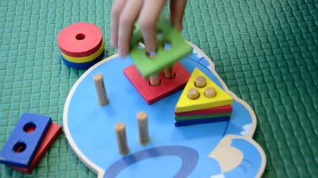 aritmética : Children toddlers girls or boy play logical toy learning shapes, arithmetic and colors at home, kindergarten or nursery Vídeos