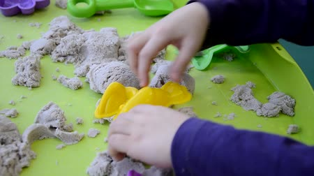 sand paper : Creative boy making figures from kinetic sand at lesson