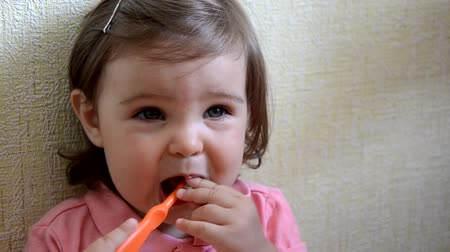 dental hygiene. happy little girl toddlers brushing her teeth. Healthy concept