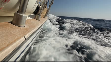 yat yarışı : Sailing in the wind through the waves (HD) Sailing boat shot in full HD at the Saronic Gulf, Greece.