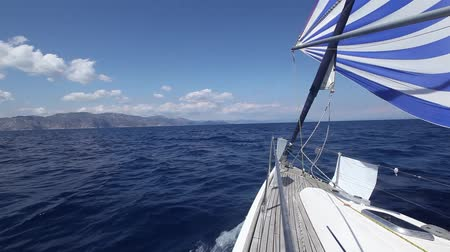 görögország : Sailing boat shot in full HD at the Saronic Gulf, Greece. Sailing in the wind through the waves (HD)