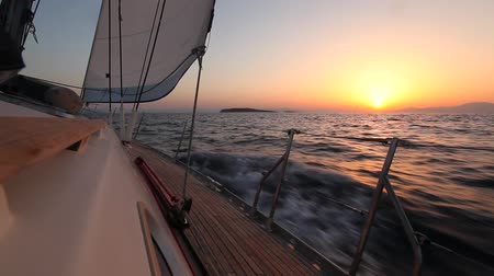 tourism : Yacht sailing against sunset. Travel Concept. Sailboat. Luxury yacht. Sailing. Vacation. (HD)