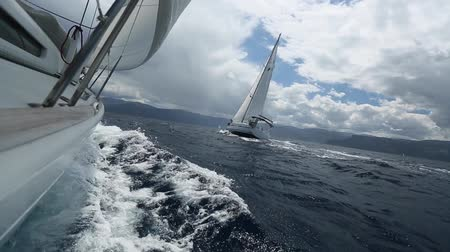 aegean sea : Sailing regatta in stormy weather. Luxury yachts. Set of camera movements. Sailing in the wind through the waves. Sailing boat shot in full HD at the Aegean Sea in Greece.
