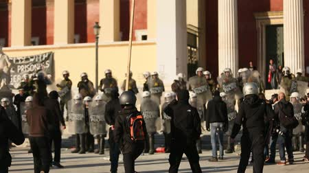 mládeži nepřístupno : ATHENS, GREECE - APR 16, 2015: Anarchist protesters near Athens University, which has been occupied by protesters - voiced support for a hunger strike by prisoners convicted under anti-terrorism laws. Dostupné videozáznamy