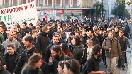 kryzys : ATHENS, GREECE - APR 16, 2015: Leftist and anarchist groups seeking the abolition of new maximum security prisons, clashed with riot police, who responded with tear gas and stun grenades.