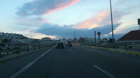 bok : ATHENS, GREECE - APR 3, 2015: Driving on a highway in Athens, view through front windshield. Going on the overpass. Greece highway.