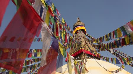 bodhnath : Prayer flags flying from the Boudhanath Stupa  symbol Kathmandu Nepal. Stock Footage