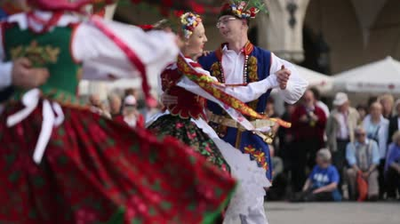 lengyelország : KRAKOW POLAND  MAY 3 2015: Polish folk collective on Main square during annual Polish national and public holiday the Constitution Day  May 3 1791 was adopted first Constitution of modern Europe.