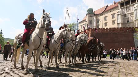 reencenação : KRAKOW, POLAND - MAY 3, 2015: Polish cavalry during annual of Polish national and public holiday the May 3rd Constitution Day. Holiday celebrates declaration of the Constitution of May 3, 1791.