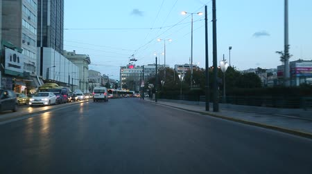 port n : ATHENS, GREECE - CIRCA APR, 2015: Driving on the streets at Athensi n the evening time, view through the front windshield.