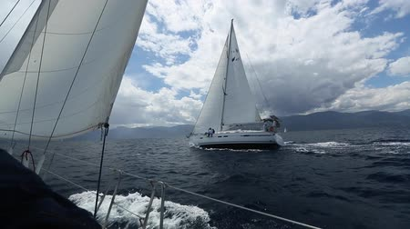 aegean sea : Sailing in the wind through the waves at the Aegean Sea in Greece. Sailing regatta. Luxury yachts.