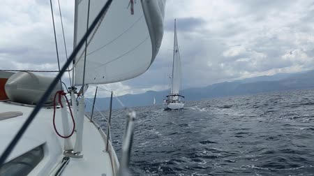 saronic : Sailing in the wind through the waves.